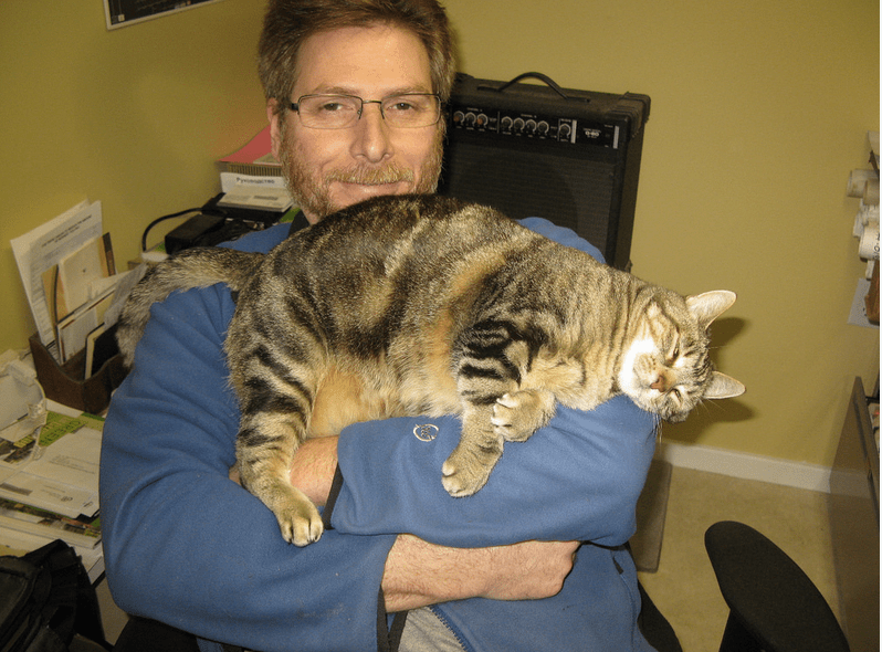 man holding a kitty