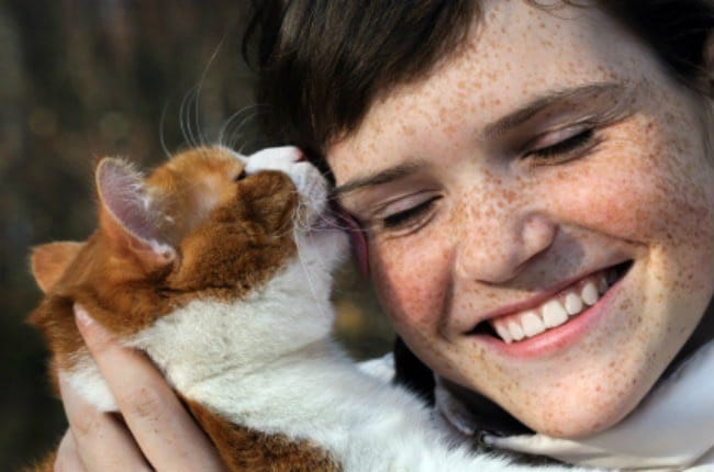 happy woman with a mature cat