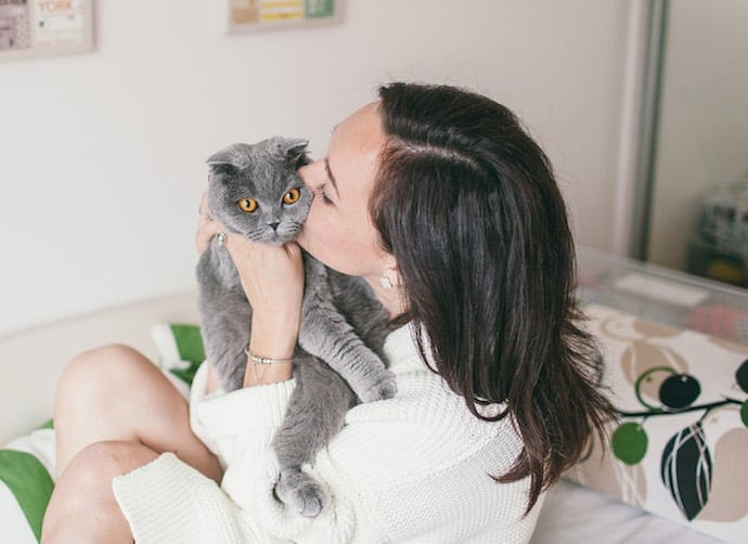 Girl with a cat on a bed