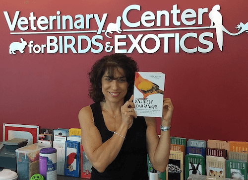 Dr. Laurie Hess with her book Unlikely Companions