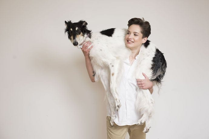 happy dog owner with a greyhound