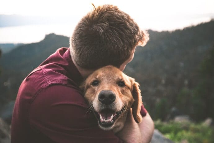 A man and a dog on a walk