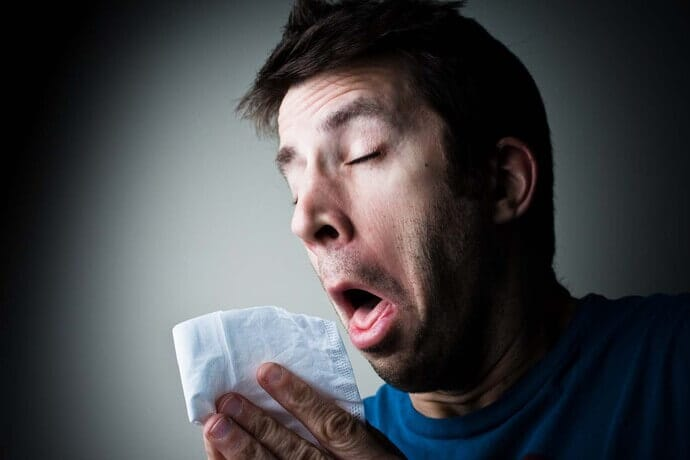 sneezing man with allergy