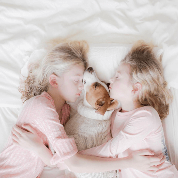 two girls with a dog